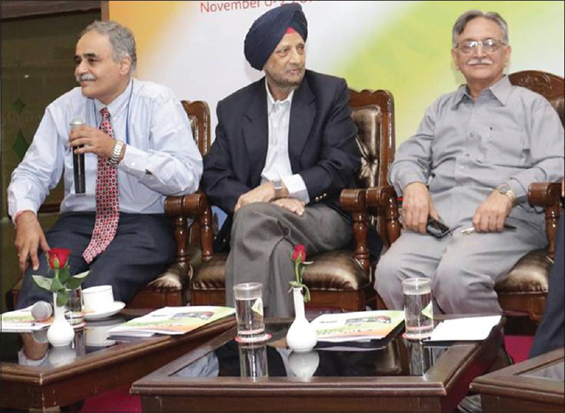 Figure 23: All Heads of the Department sharing a light moment at a press conference. From left to right: Dr. Vivek Lal, Dr. Jagjit Singh Chopra, and Dr. Sudesh Prabhakar